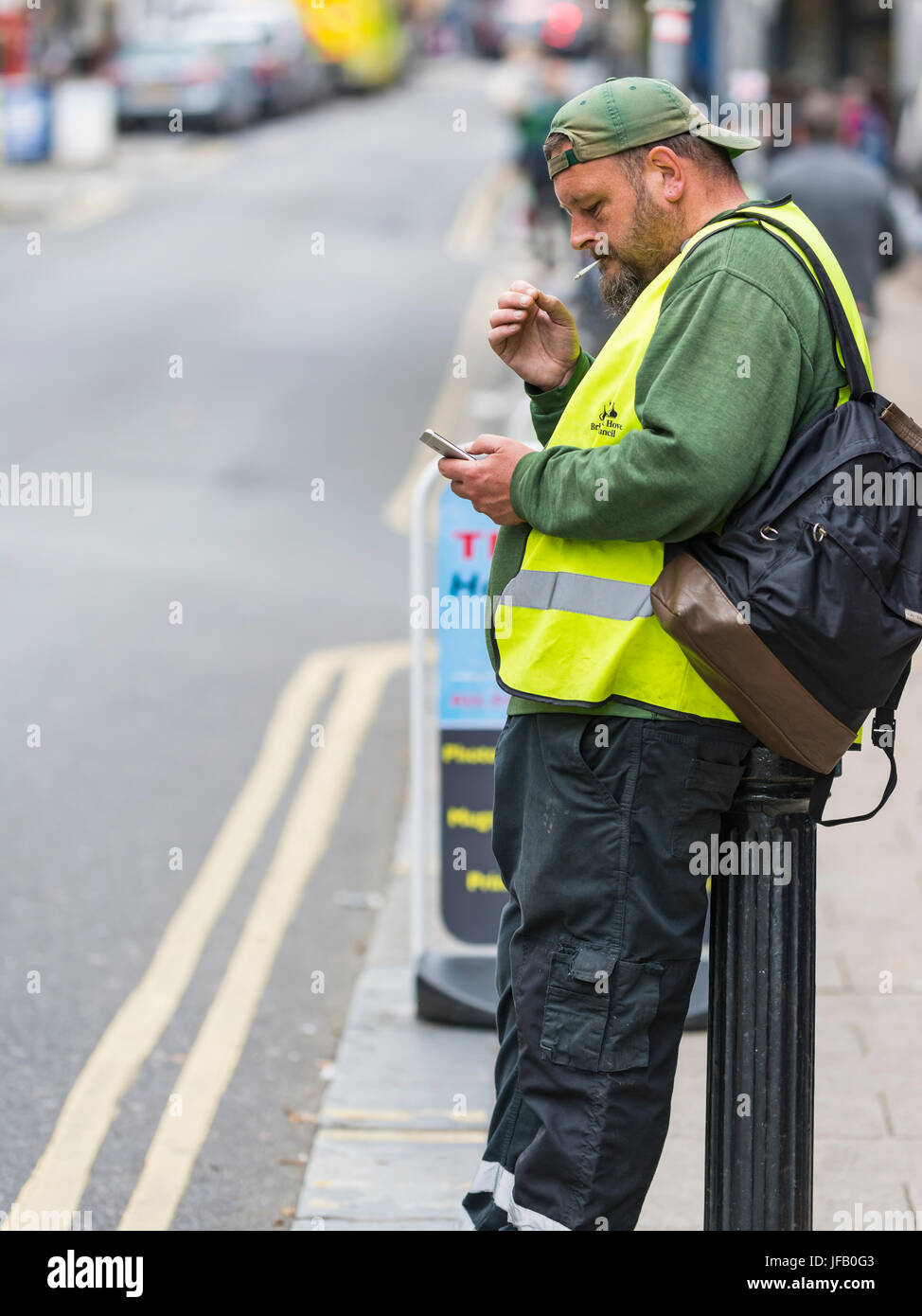 Man smoking on the street. - Stock Image