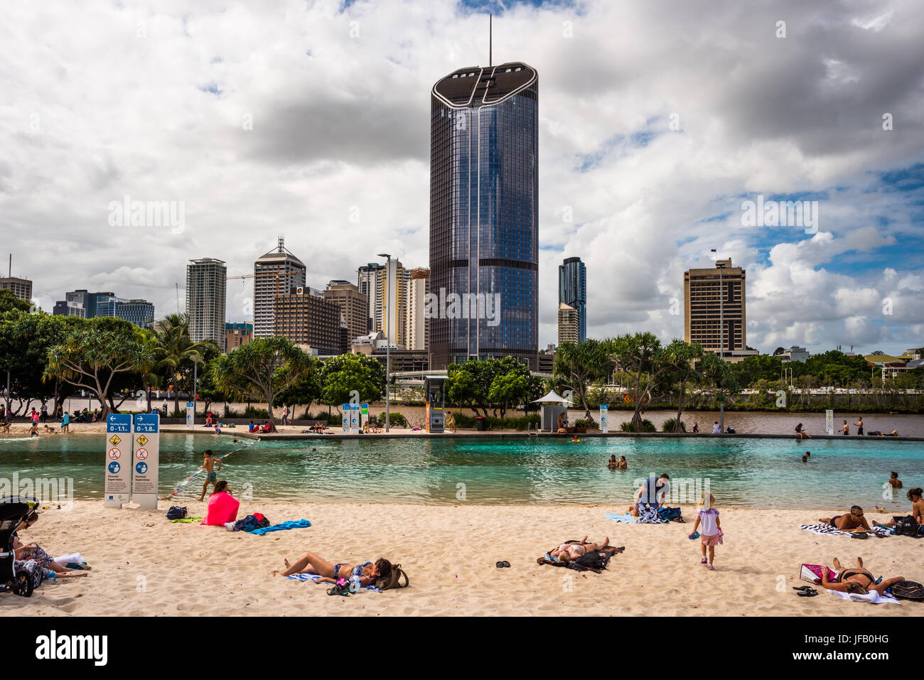 Streets Beach lagoon in the South Bank Parklands with city skyline in background. Brisbane, Queensland, Australia - Stock Image