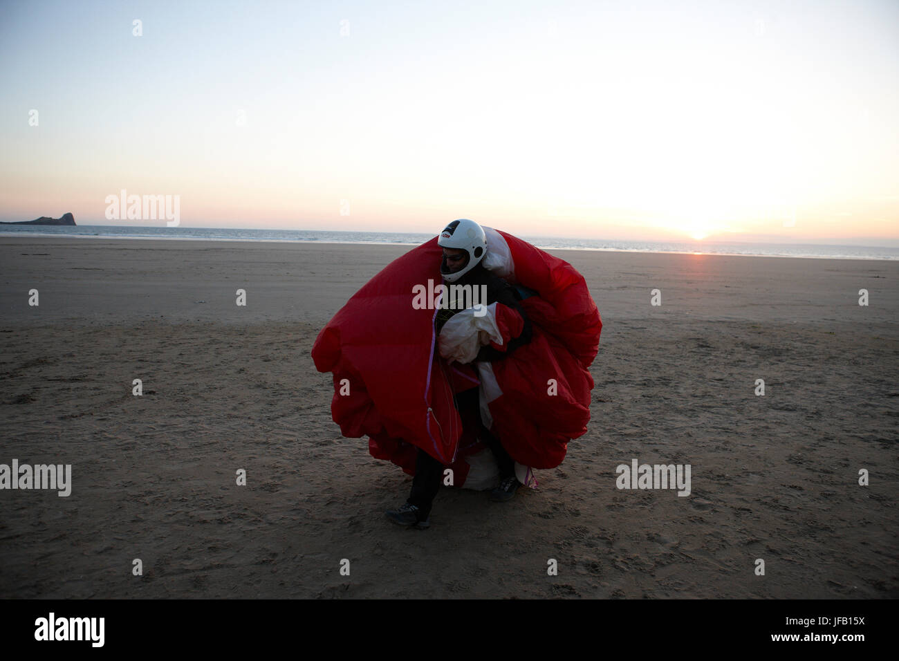 A Paraglider has landed on a beach at sunset, Stock Photo