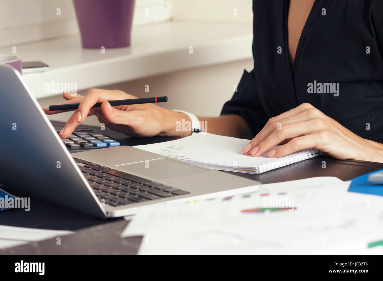 Close up view of bookkeeper or financial inspector hands making report, calculating or checking balance. Home finances, - Stock Image