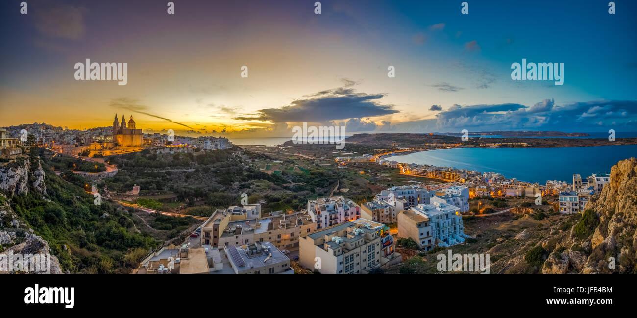 Il-Mellieha, Malta - Beautiful panoramic skyline view of Mellieha town at sunset with Paris Church and Mellieha - Stock Image