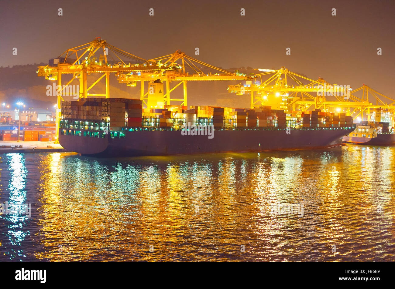 Commercial dock at night - Stock Image