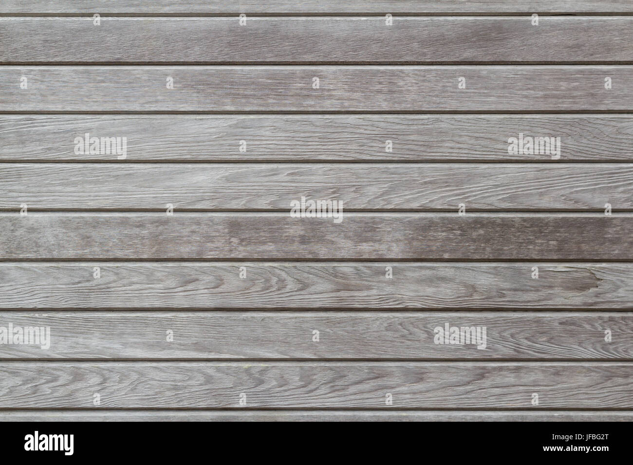 Weathered grey brown wood texture with natural patterns, horizontal, background - Stock Image