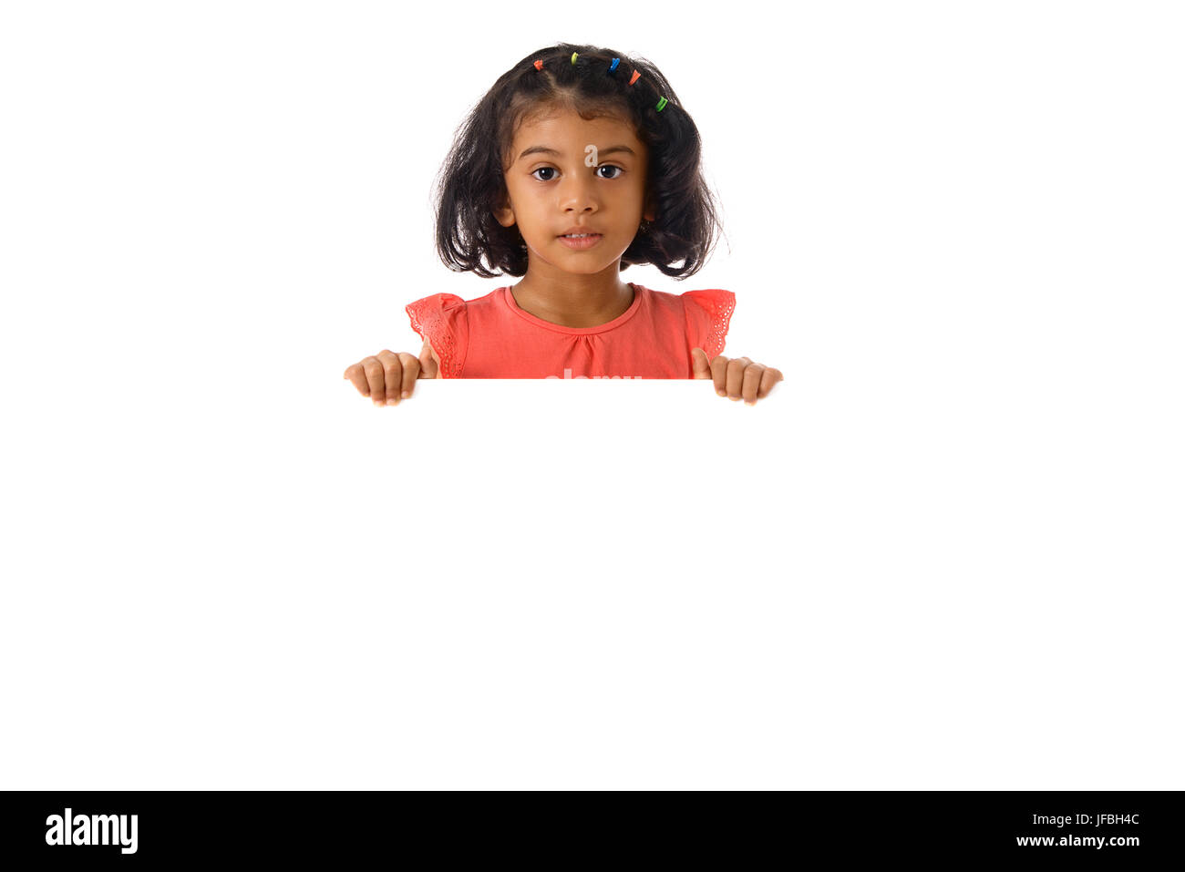 Portrait of little girl in studio with white board. Isolated .Copyspace Stock Photo