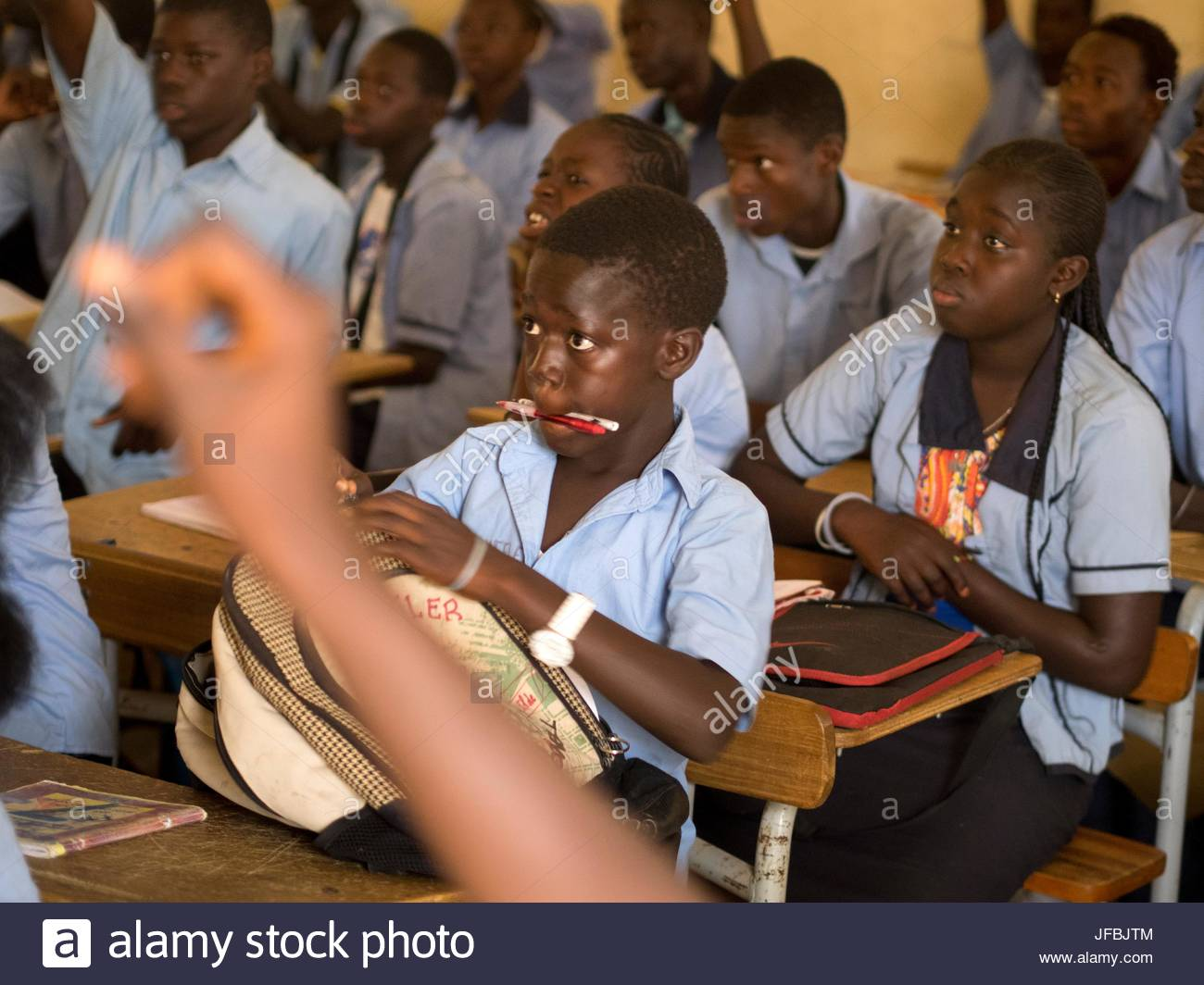 14 year old students in a classroom at their desks. - Stock Image
