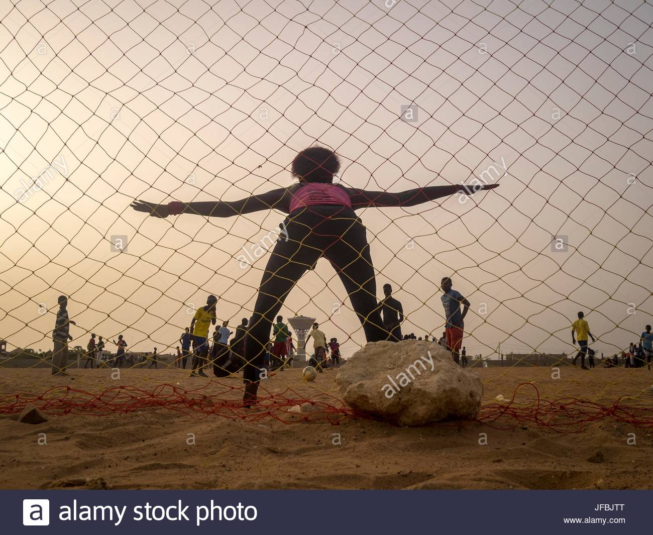 Boys and girls from La Somone playing soccer on the grounds of their school, the Lycee Somone-Ngaparou School. - Stock Image