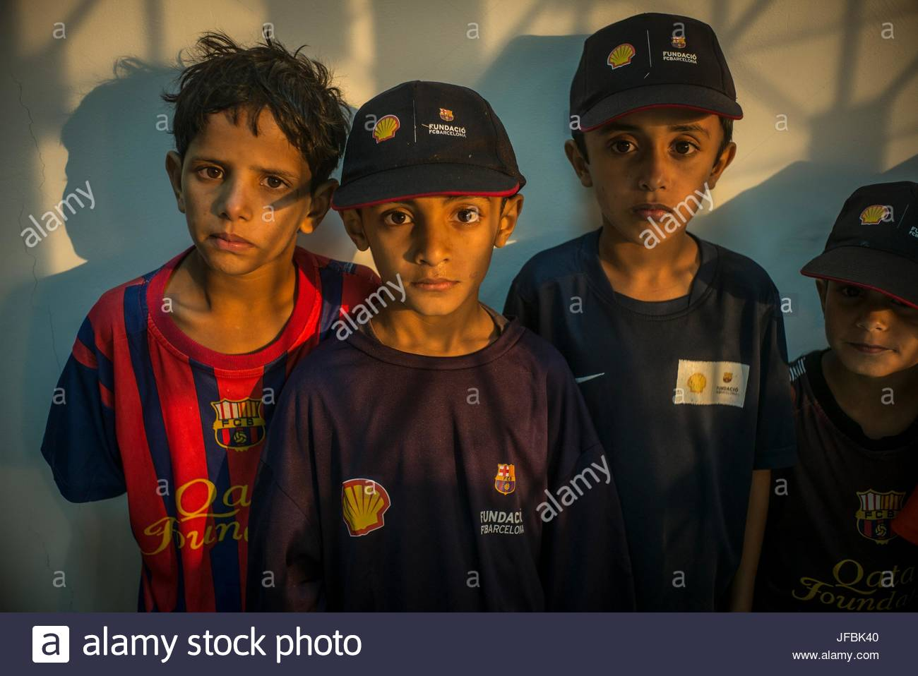 Young soccer playing boys from Bidiyah after a FutbolNet session. - Stock Image