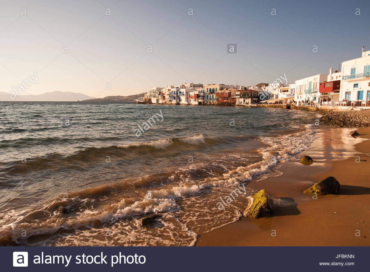 A shoreline view of the Little Venice neighborhood, and gentle surf. - Stock Image
