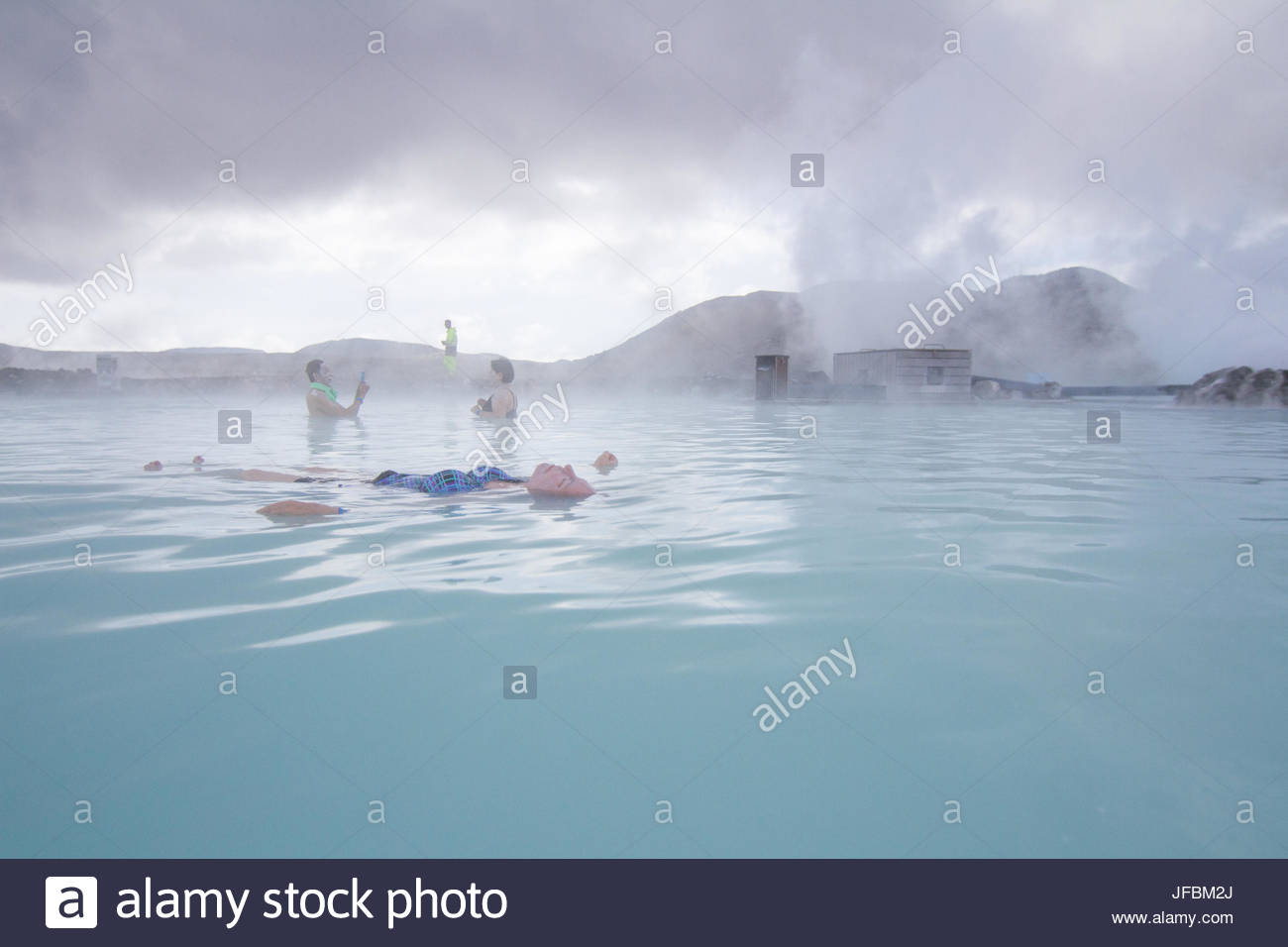 People relaxing in the geothermal hot springs at Blue Lagoon. Stock Photo