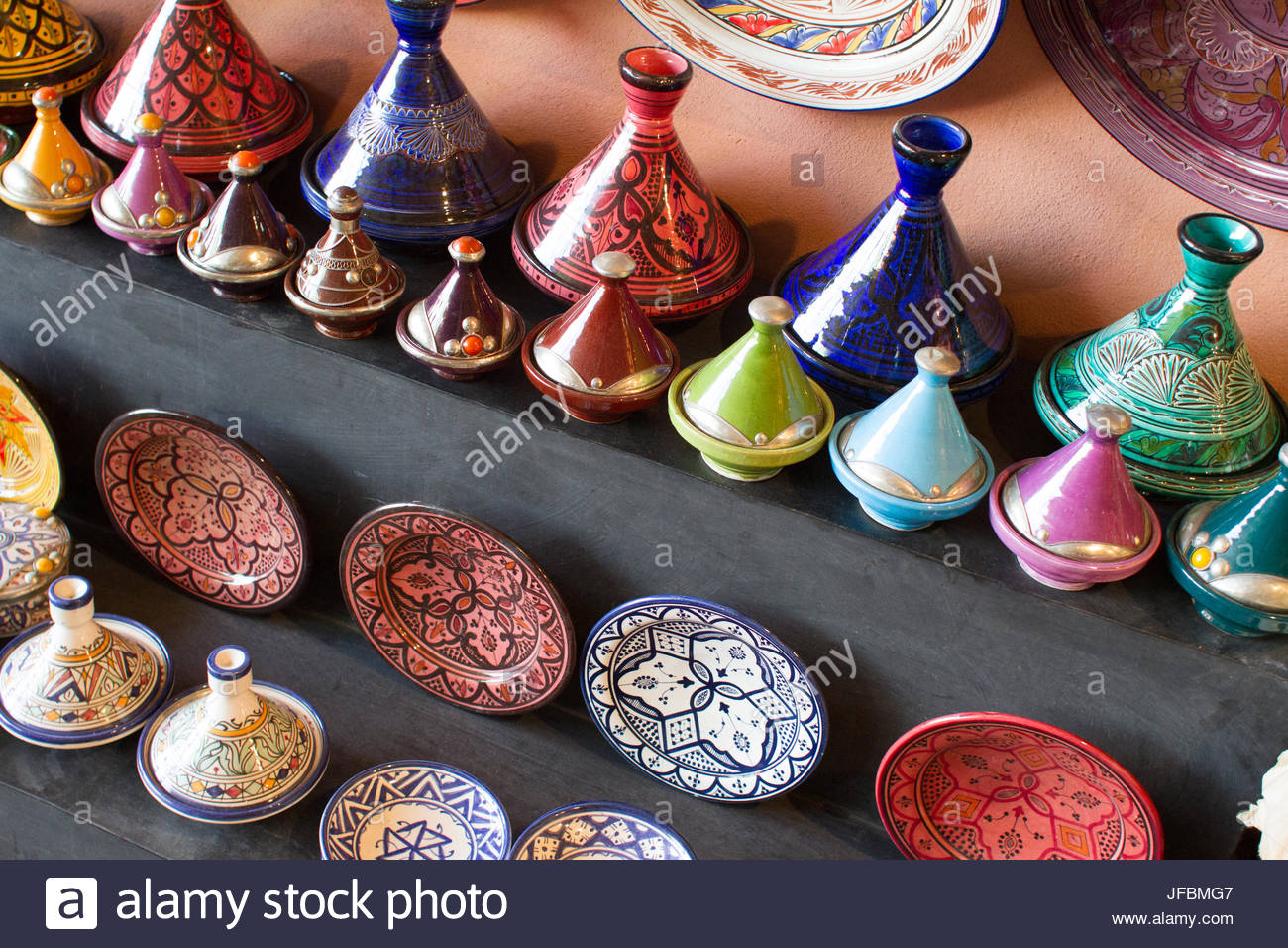 Colorful tagines and other pottery dishes for sale. - Stock Image