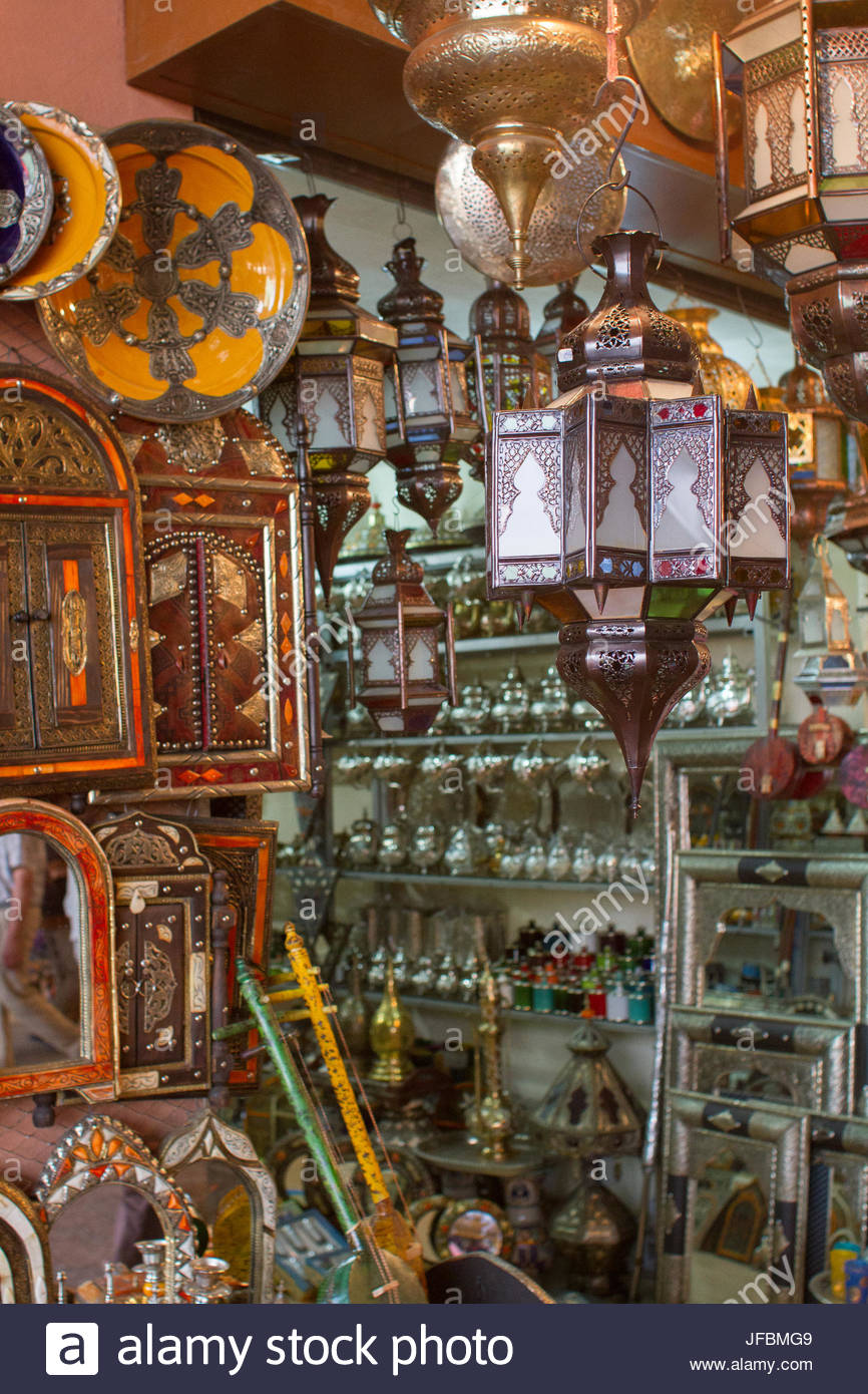 Ornate lanterns, teapots, and mirrors for sale at a shop in Marrakech. - Stock Image