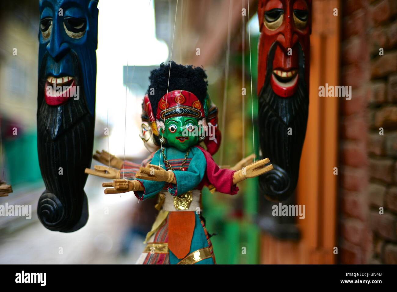 A handmade Nepalese puppet. - Stock Image