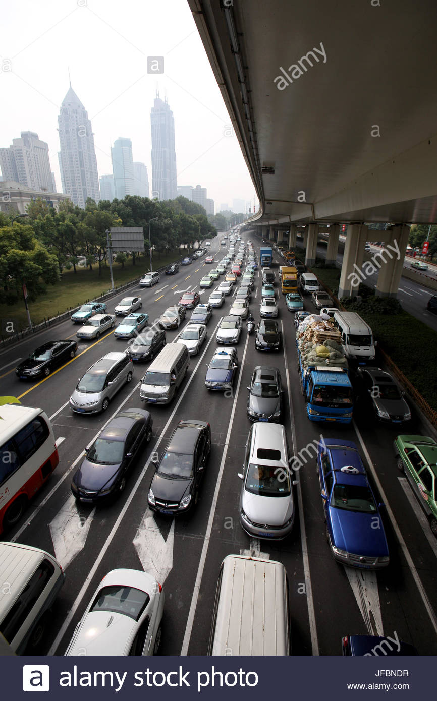 Heavy traffic under an overpass in central Shanghai. - Stock Image