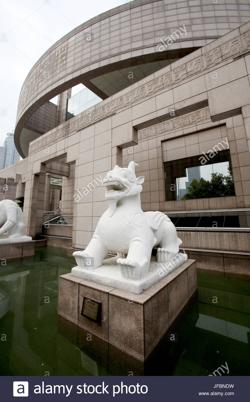 A stone statue of a mythological beast guards the entrance to the Shanghai Museum. - Stock Image