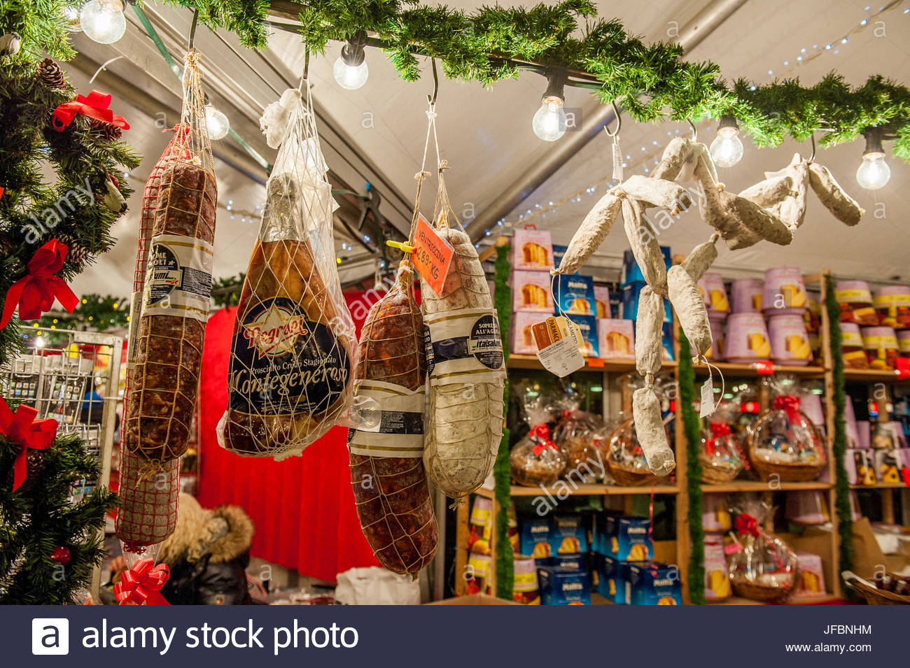 Smoked sausages and cured meats at a Christmas market. - Stock Image