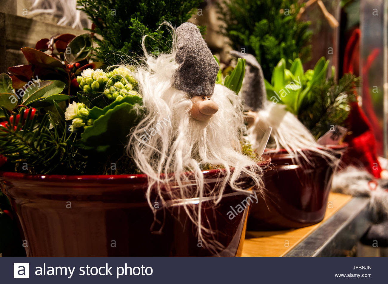 Christmas gnomes and decorations for sale - Stock Image