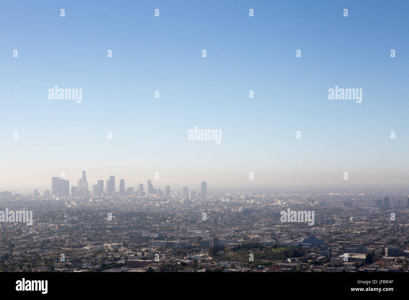 A view to downtown Los Angeles and surroundings from Griffith Observatory. Air pollution is visible over the city. - Stock Image