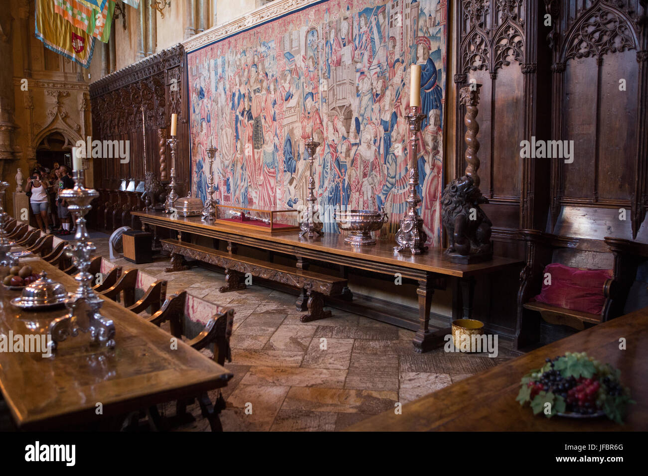 Tourists enter the dining room at Hearst Castle, which has extensive furniture, tables, tapestries, sculptures and - Stock Image