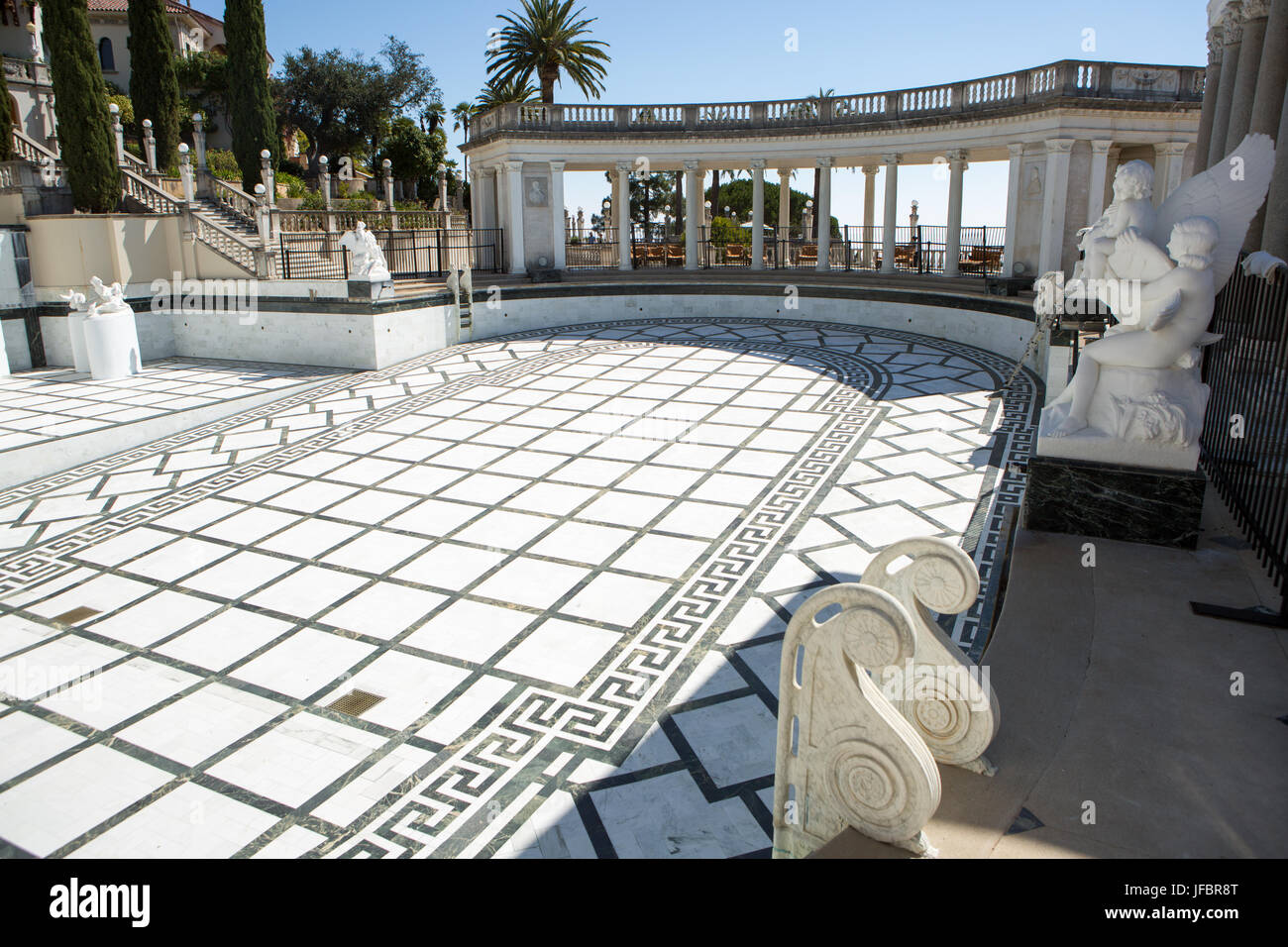 The Neptune Pool at Hearst Castle, empty for restoration, is surrounded by a sitting area and sculptures. - Stock Image