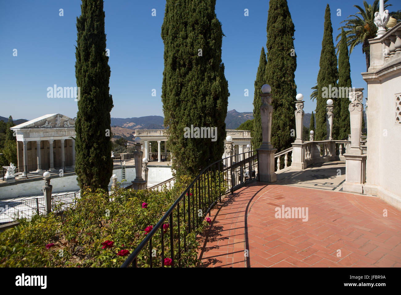 The Neptune Pool and veranda at Hearst Castle are landscaped with trees and plants. Stock Photo
