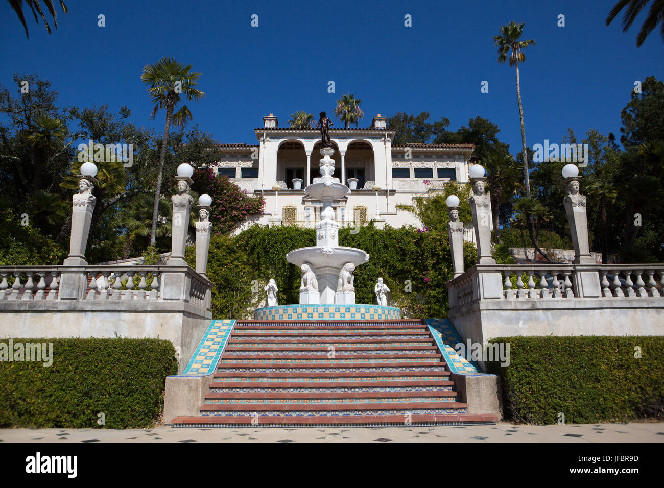 The staircase leading from cottage House A, Casa del Mar, to the Neptune Pool, fountain and veranda at Hearst Castle. - Stock Image