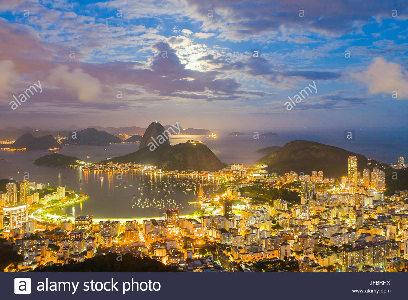 Aerial view overlooking the entire city of Rio de Janeiro including Sugarloaf Mountain in Brasil. - Stock Image