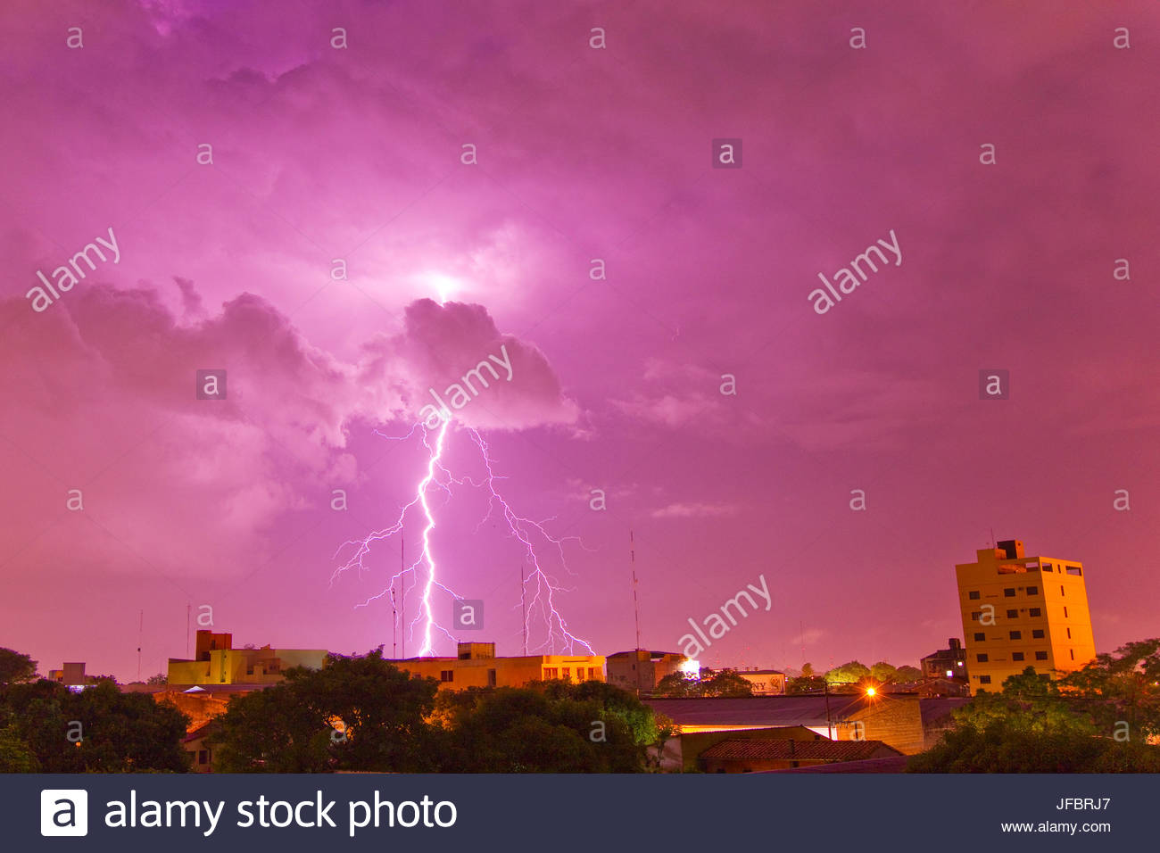 A lightning bolt striking down in the city of Asuncion, Paraguay during an intense lightning storm. - Stock Image