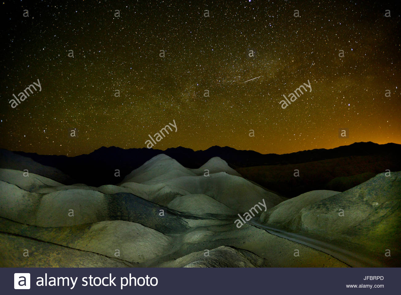 A starry sky over Twenty Mule Team Canyon. - Stock Image