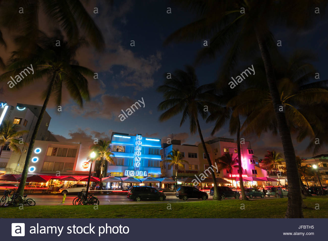 The Colony Hotel and Ocean Drive at dusk. - Stock Image