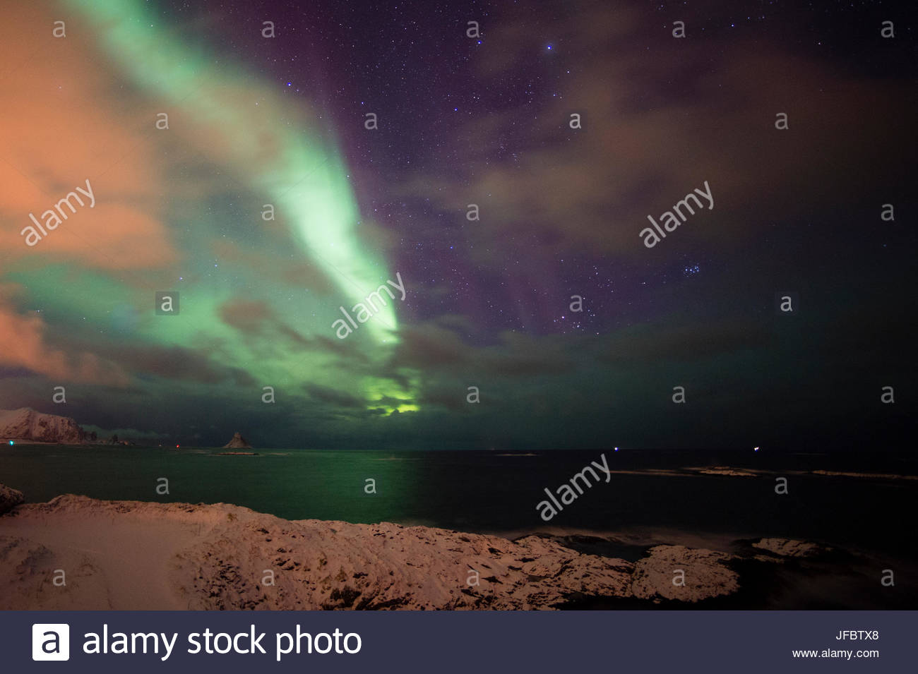 An aurora borealis above the sea in Andenes. - Stock Image