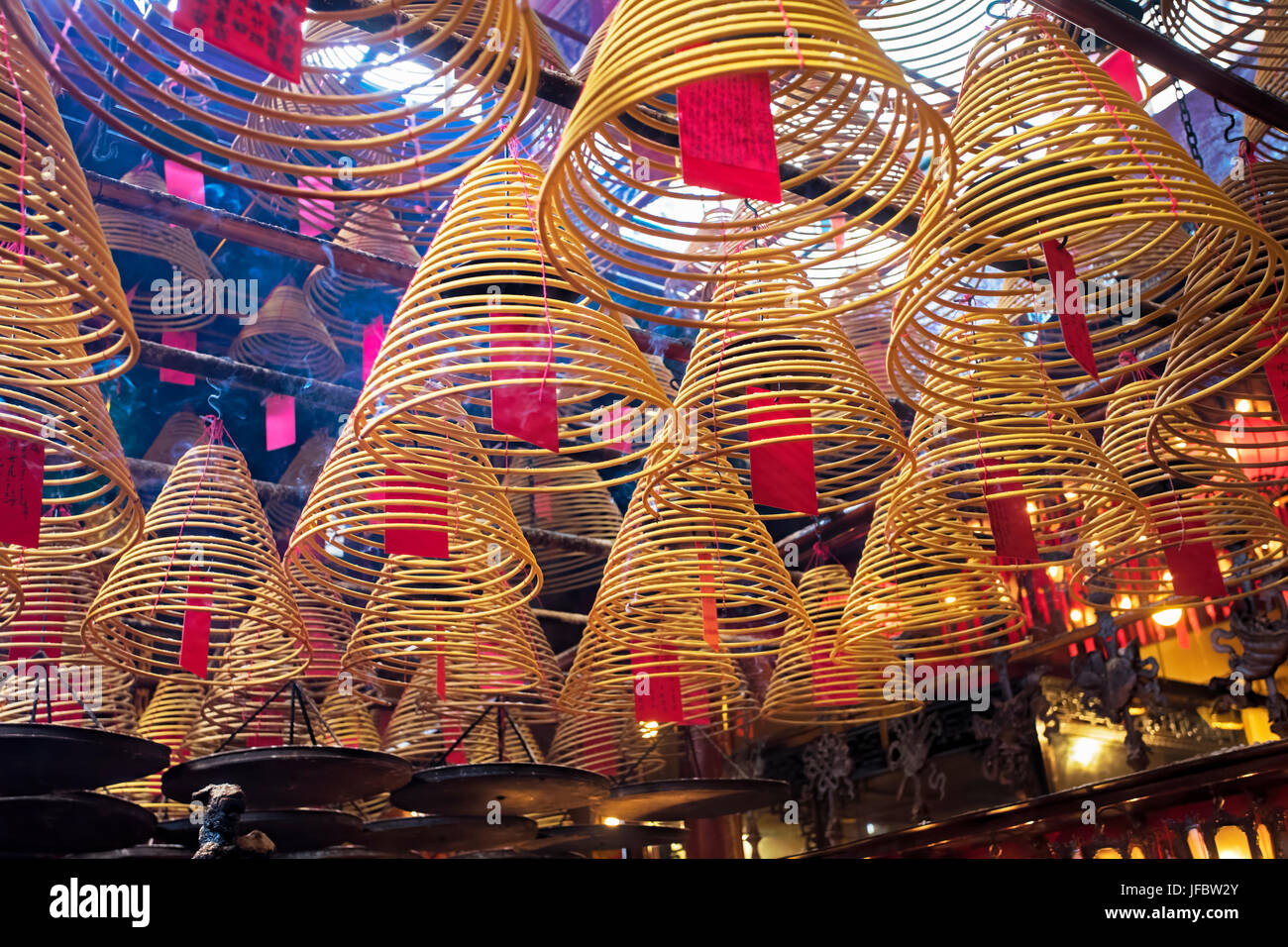 Incense burning in the Man Mo Temple, the most famous Taoist temple in Hong Kong China - Stock Image