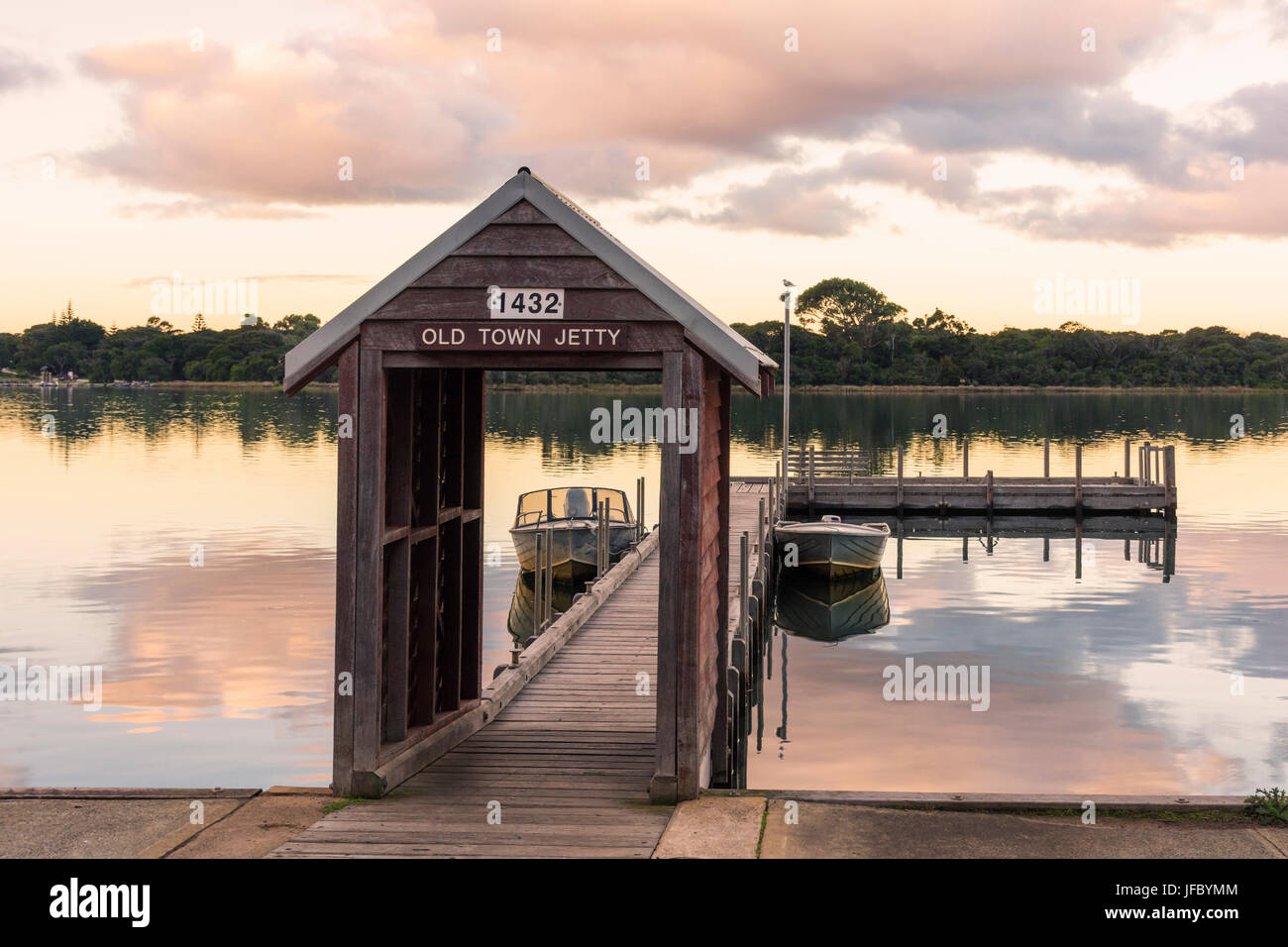 Old town wooden jetty on Hardy Inlet at sunset, Augusta, Western Australia - Stock Image