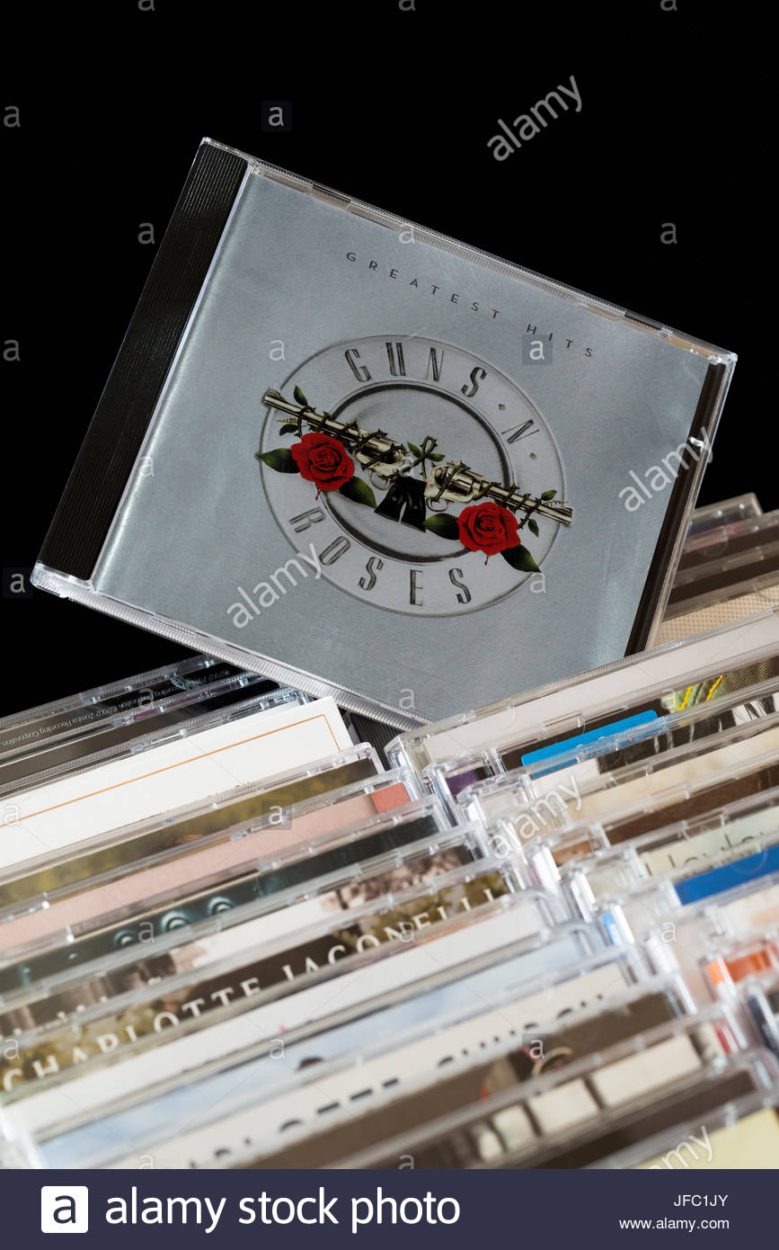 Guns N Roses Greatest Hits CD pulled out from among rows of