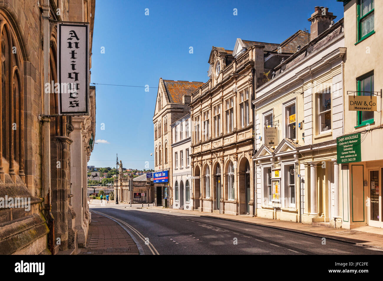 18 June 2017: Barnstaple, Devon, England, UK - Fine old buildings in Cross Street. Queen Anne's Walk has the - Stock Image