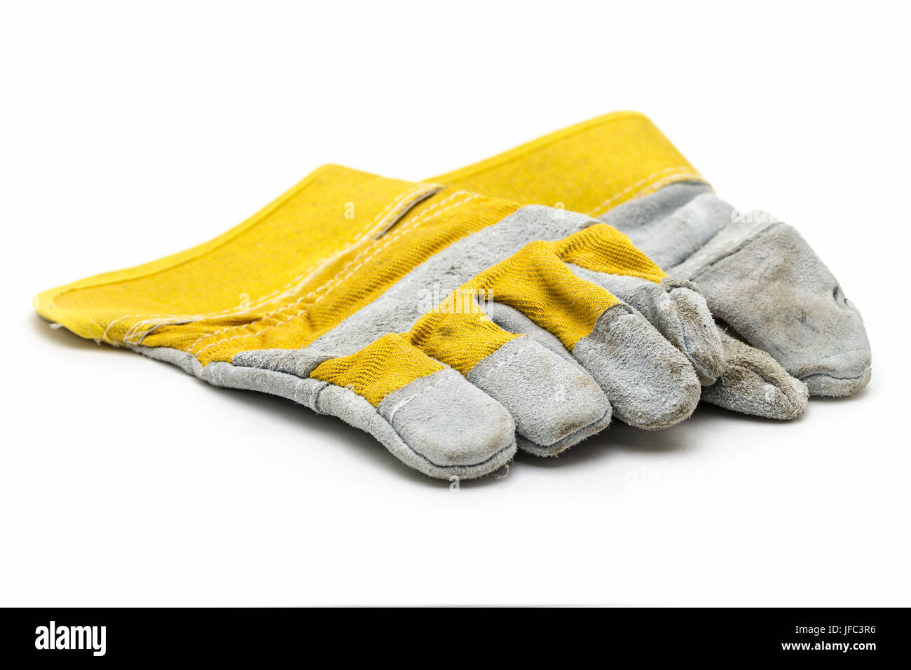 Suede construction gloves closeup on a white background. - Stock Image