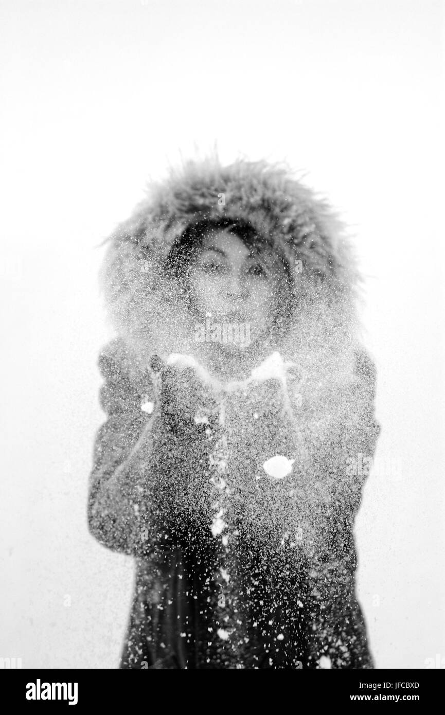 Young female playing with snow - Stock Image