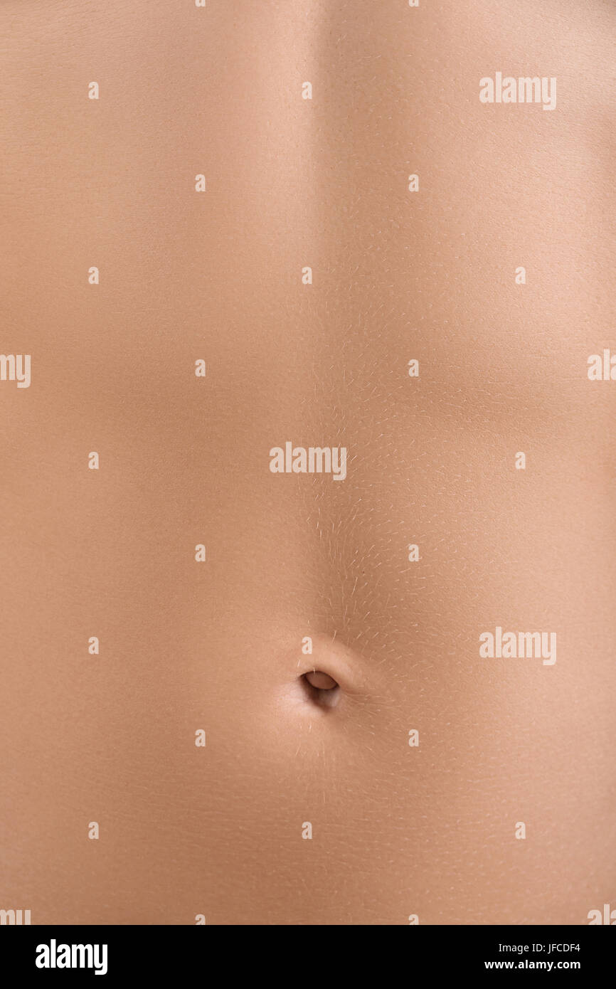Beautiful lady abdomen close-up background. Wellbeing and fitness concept - Stock Image