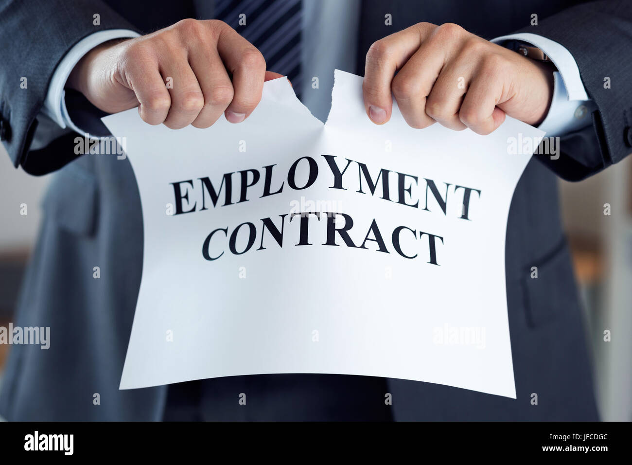 Close up of businessman hands breaking employment contract. Boss dismissing an employee. Bankruptcy, redundancy - Stock Image