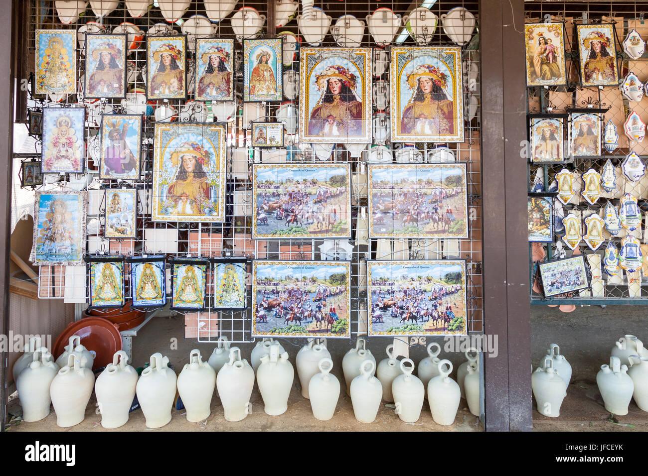 El Rocio, Spain - June 2, 2017: Icons of the Madonna of El Rocio for sale in a shop during the pilgrimage Romeria - Stock Image