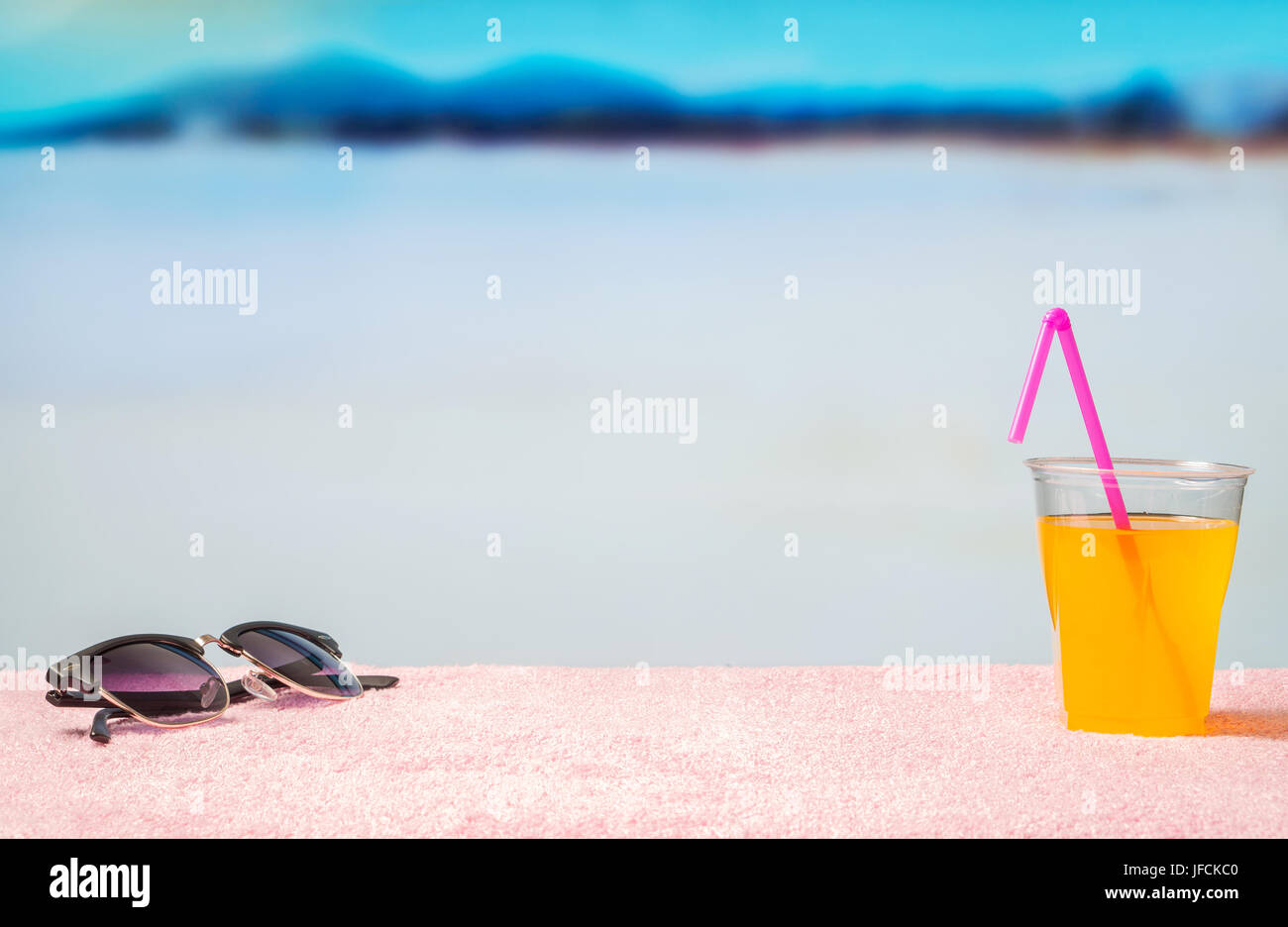 Paradise holiday background with yellow cocktail on sunglasses on beach. Perfect for summer sales and offer campaign - Stock Image