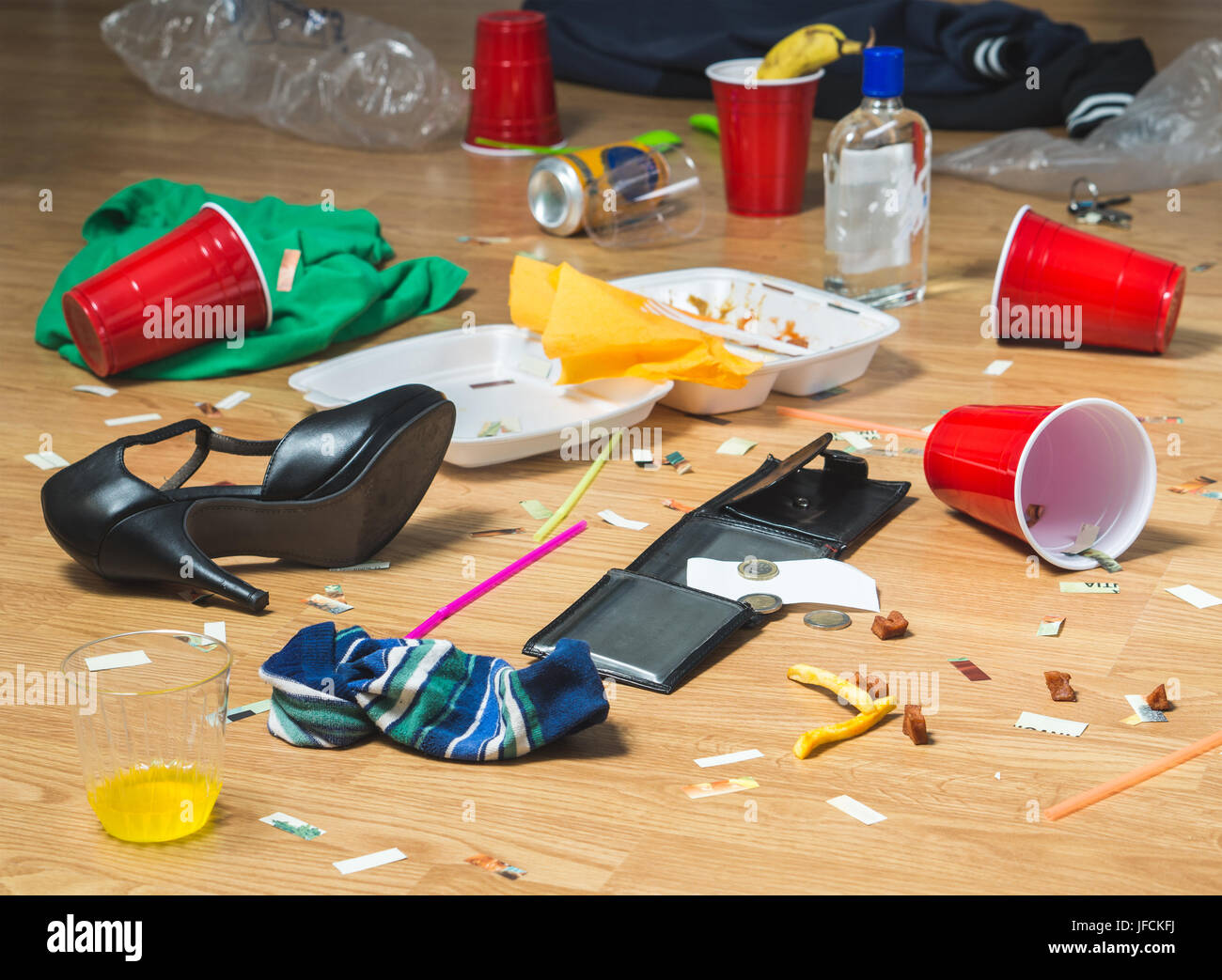 Next morning to a party. Horrible mess and chaos after crazy night at partying and drinking. Trash, bottles, food, - Stock Image