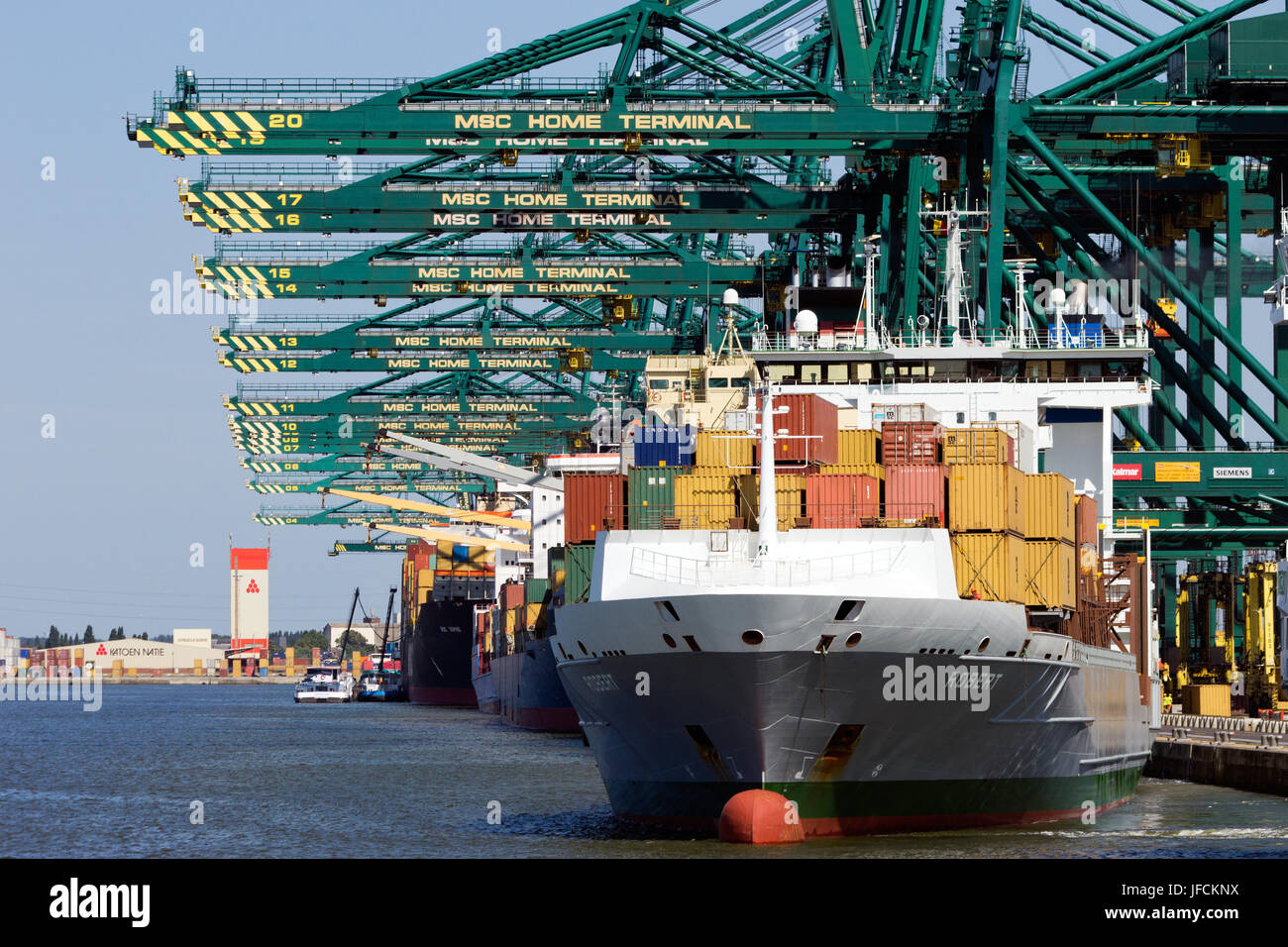 ANTWERP, BELGIUM - JULY 9: Container ship leaving MSC Home terminal July 9,2013 in Antwerp, Belgium. MSC Home terminal - Stock Image