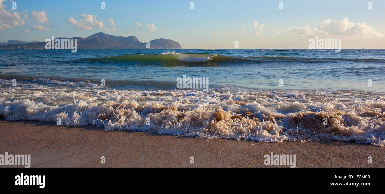 Sea wave on the sand - Stock Image