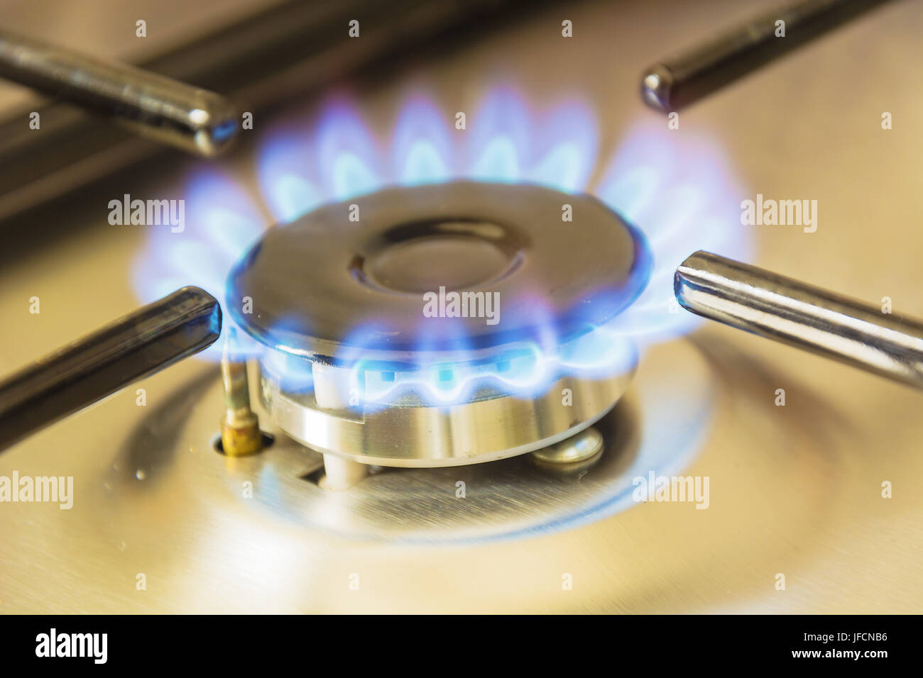 gas burning from a stove - Stock Image