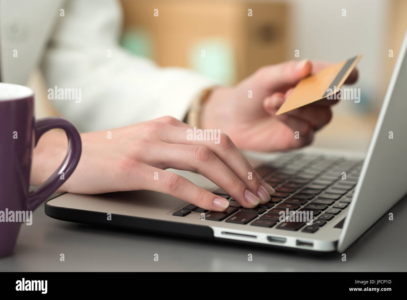 Close up view of businesswoman hands holding credit card and making online purchase using notebook pc. Shopping, - Stock Image