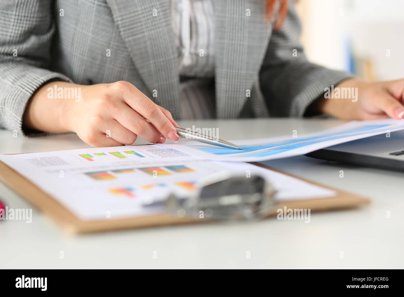 Businesswoman looking at graphics. Manager or auditor reading reports. Financial planning, business analysis and - Stock Image