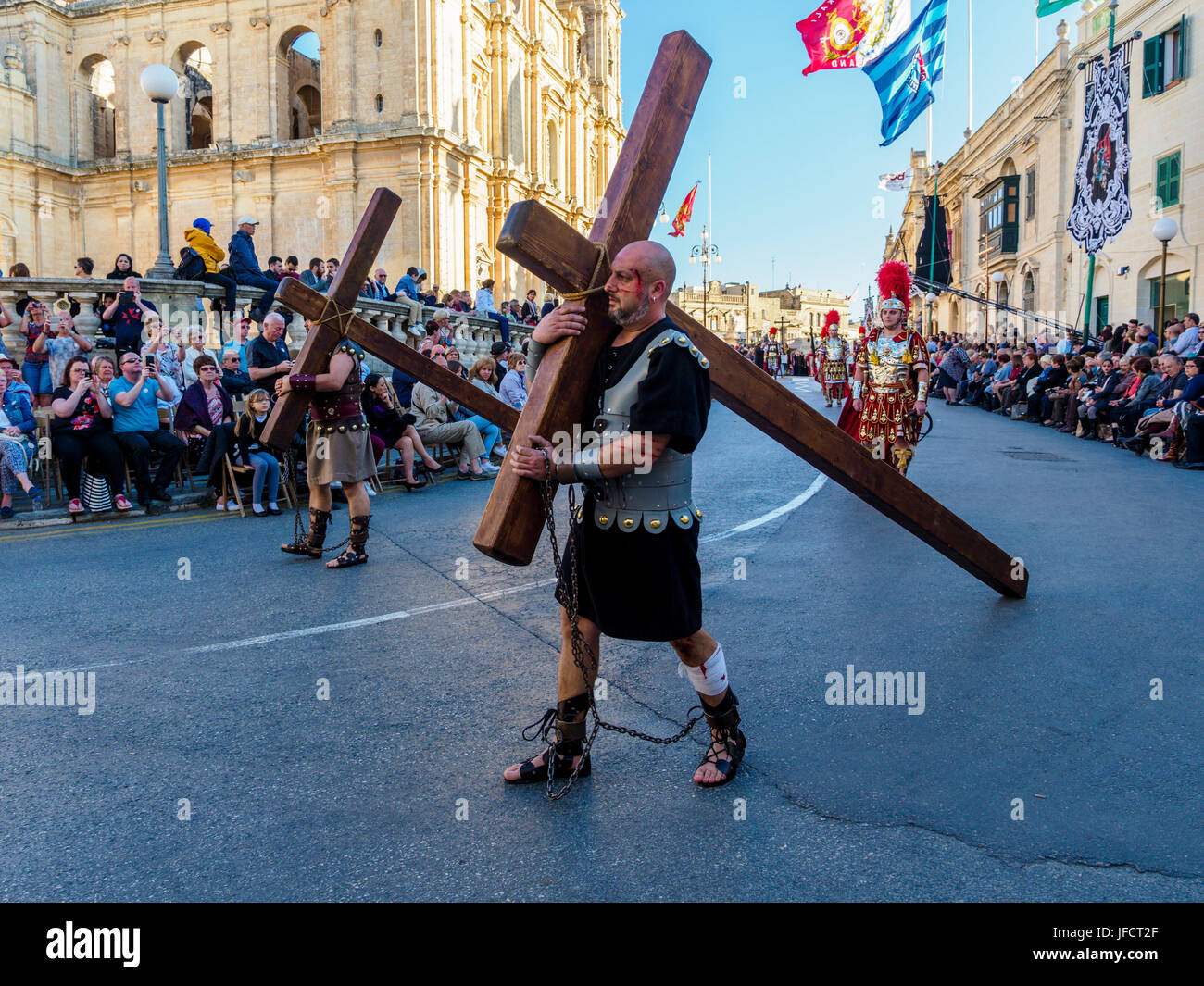 Inhabitants of Zejtun / Malta had their traditional Good Friday procession in front of their church, two of them - Stock Image