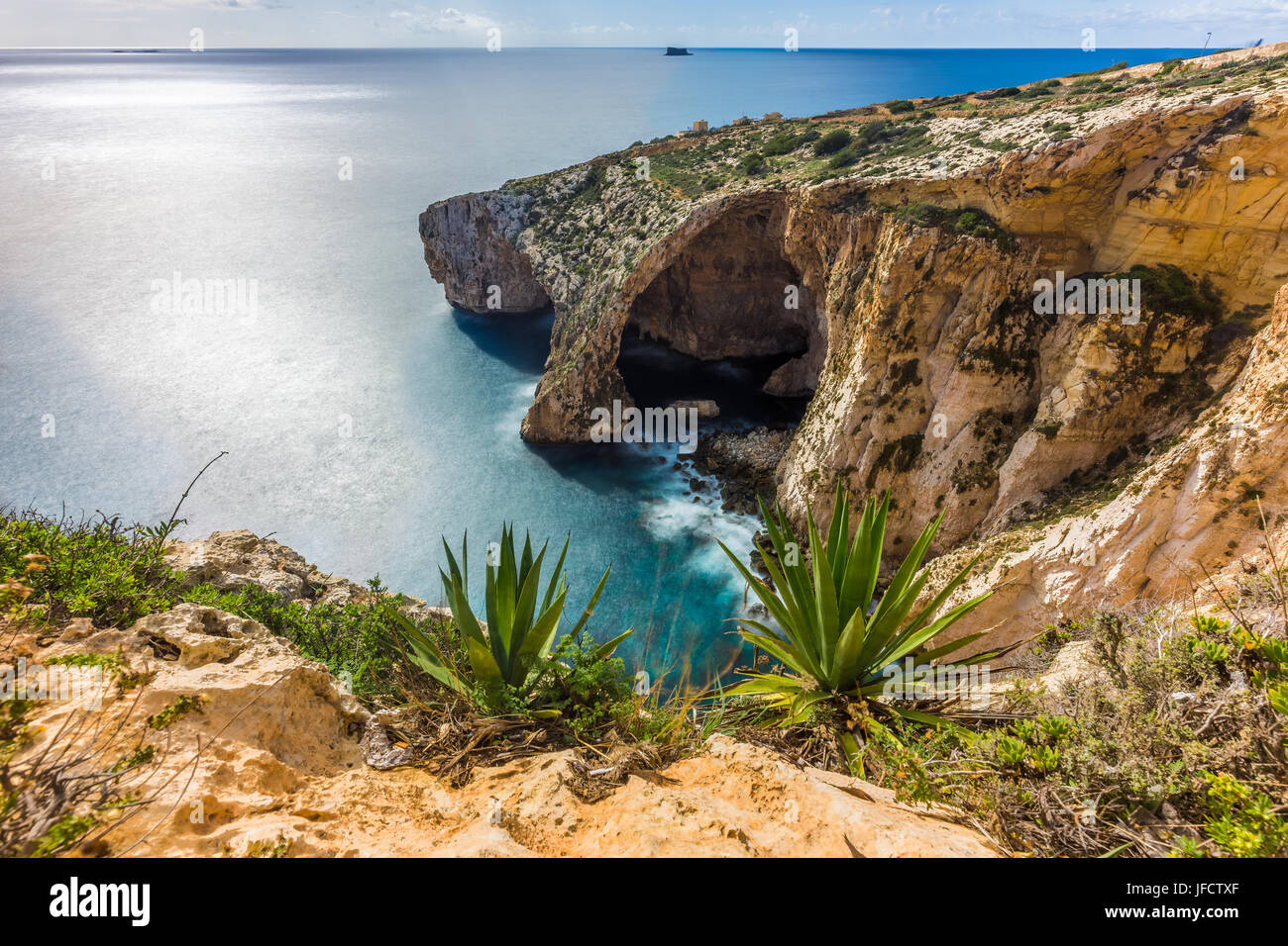 Malta - The famous arch of Blue Grotto cliffs with green leaves - Stock Image