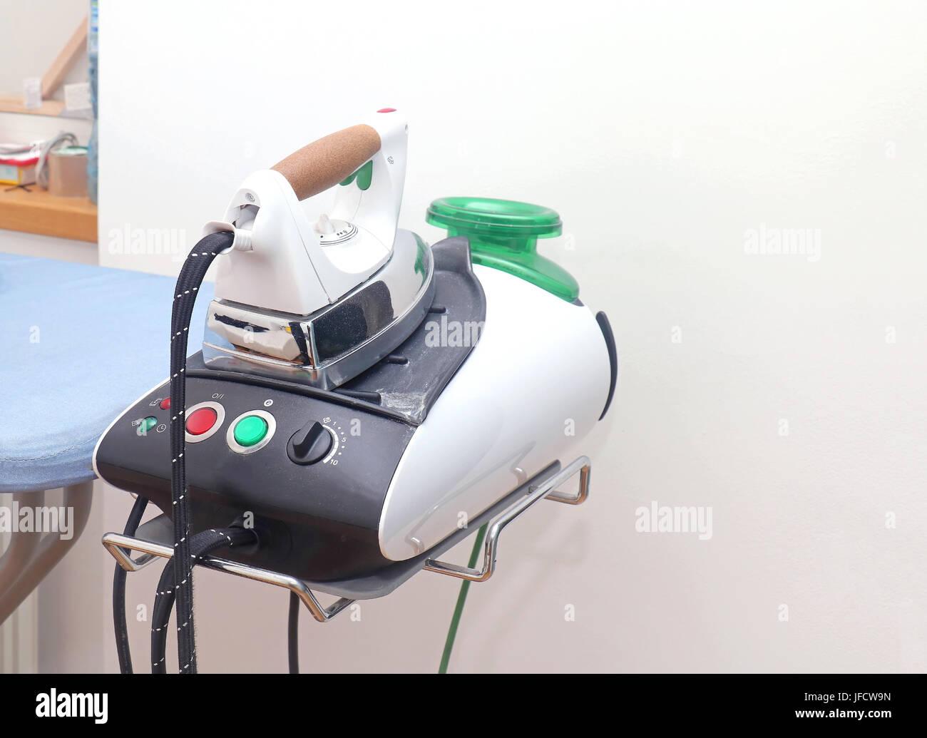 Modern ironing room - Stock Image