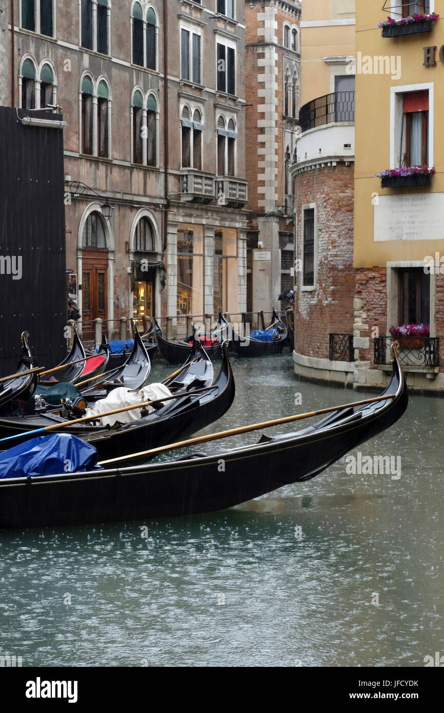 View of gondolas on the backside of Hotel Cavelletto from Bacino Orseolo on a rainy day, Venice, Italy - Stock Image